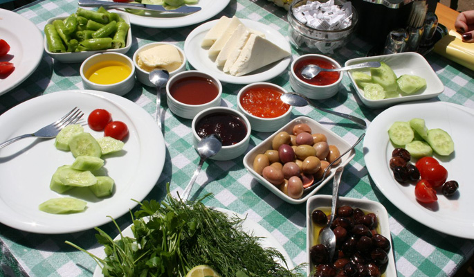 Start another day in paradise with a Turkish breakfast of local cheeses, olives and honey, eggs, preserves, slices of cucumber and tomato and bread