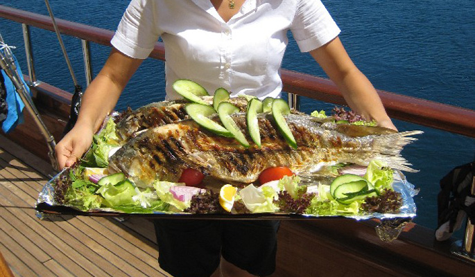 Fresh locally caught fish and seafood is served Aegean style