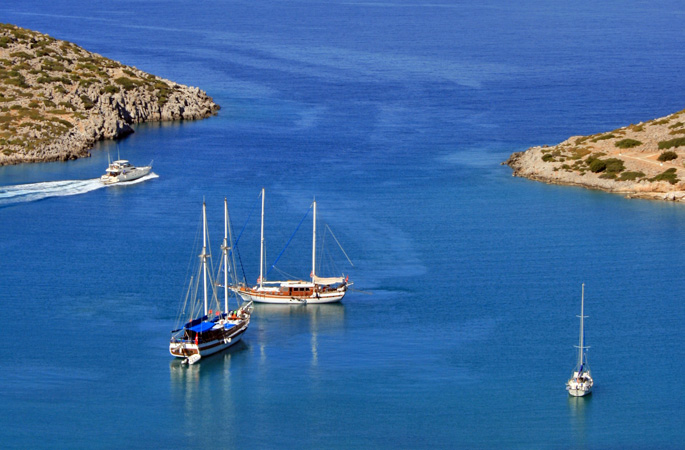 Luxury gulet charter yachts moored in secluded bays