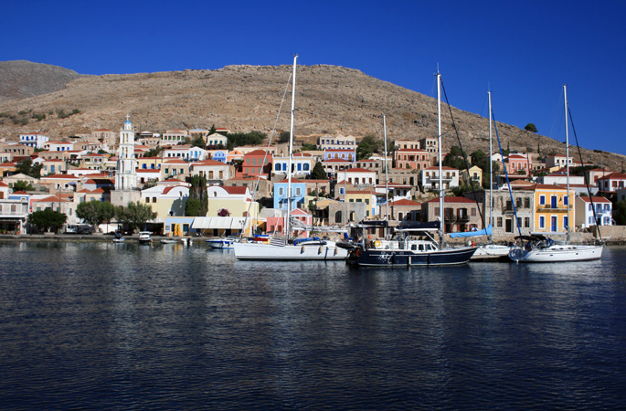 The painted Neo-Classical facades in the harbour on Tilos Island