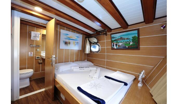 Sun deck with loungers and dining area