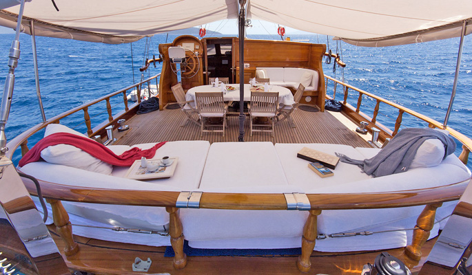 Aft deck with shaded dining and lounge area