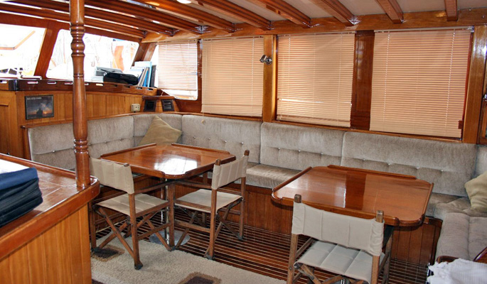 Spacious and relaxing saloon with dining area below deck