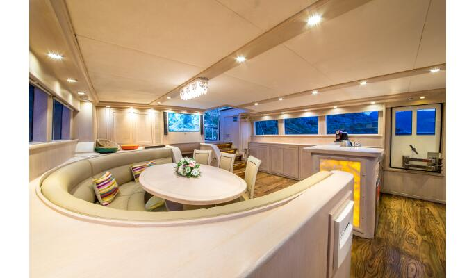 Aft deck dining area and luxurious lounge seating