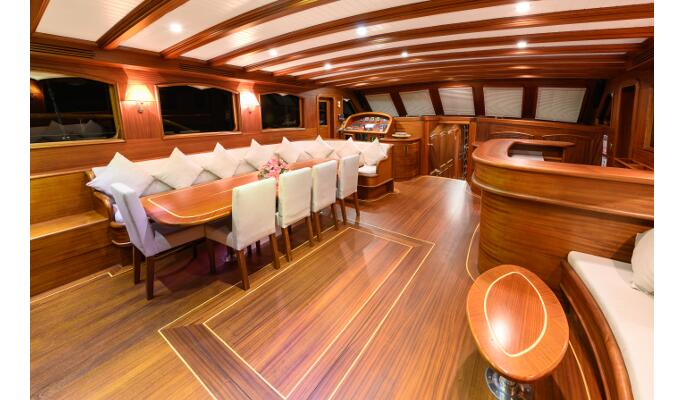 Interior saloon area for relaxing and dining below deck