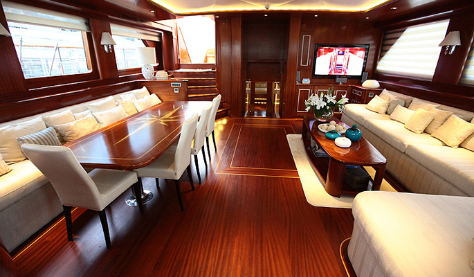 Chic and classic interior saloon with dining, lounge area and TV, DVD & music entertainment