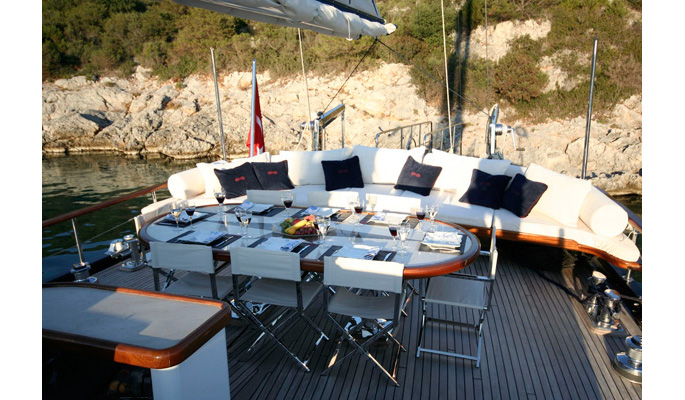Aft deck dining area with luxurious sofa seating