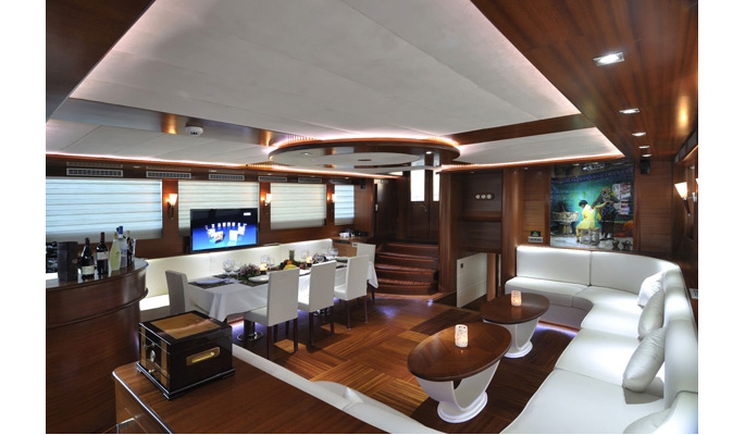 Chic interior saloon with dining area, sofa lounge and plasma TV