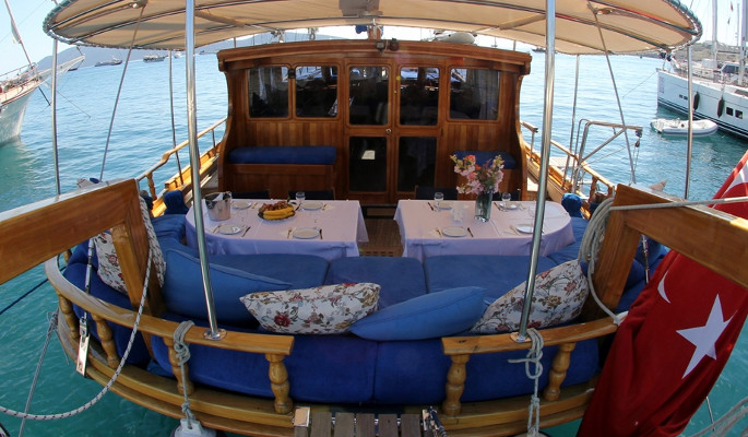 Aft deck dining area and cushioned sofa seating