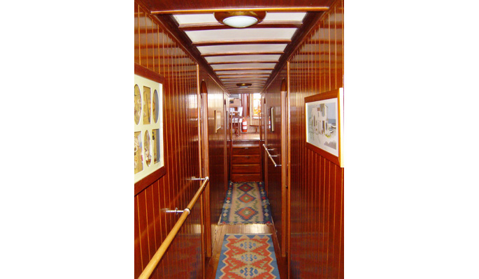 Below deck corridor access to cabins