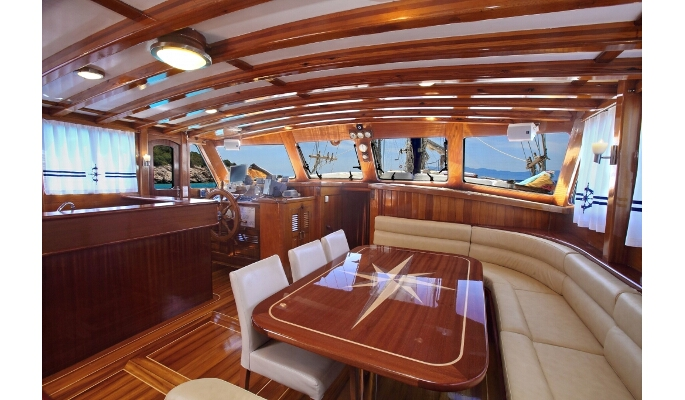 Aft deck for dining al fresco and sofa seating area