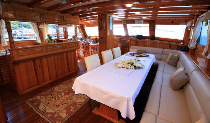 Yacht's interior saloon with bar, lounge and dining area