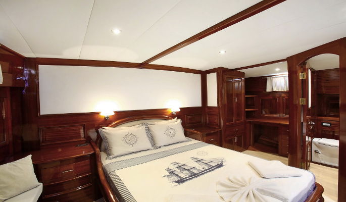 High ceilinged and immaculately designed interior saloon and dining area