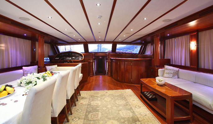 Elegant and spacious saloon with sofa and dining area