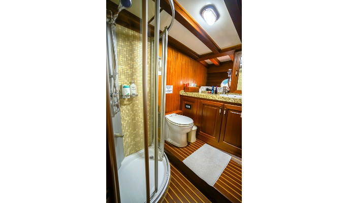 Large aft master cabin with en suite with desk and sofa suitable for a child sleeping