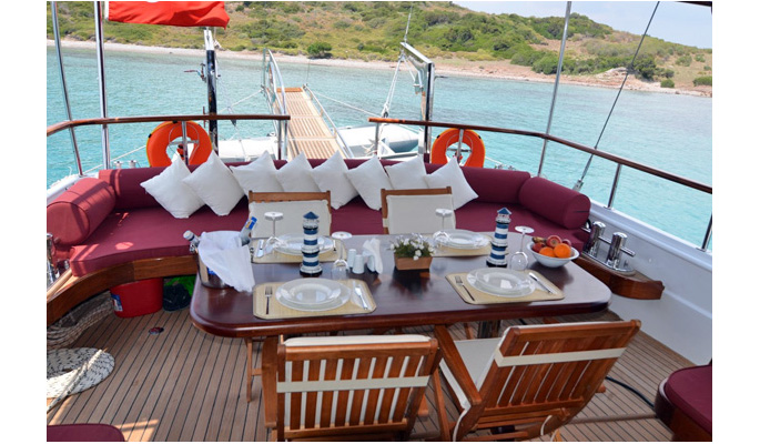 Relaxing shaded dining area on aft deck