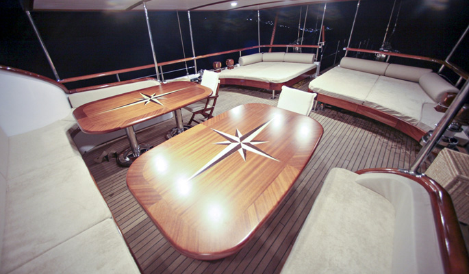 Aft deck shaded dining and luxurious cushioned lounge area