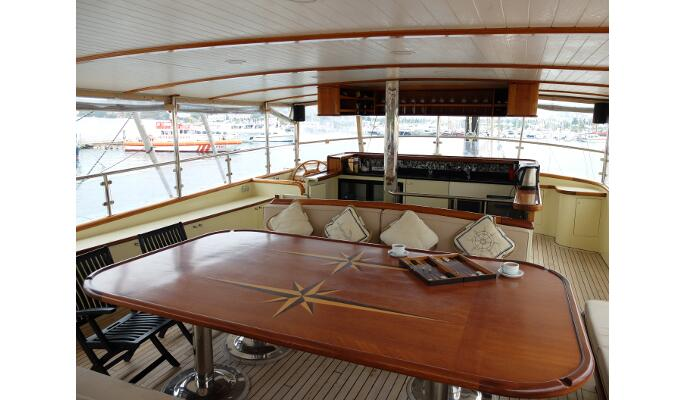 Top deck fly bridge with bar and seating areas