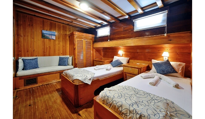 Large master cabin with sofa, ample storage and en suite