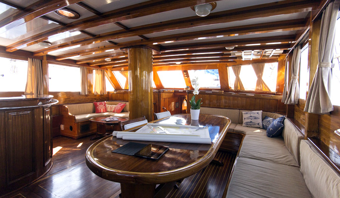 Interior dining area and saloon for relaxing below deck