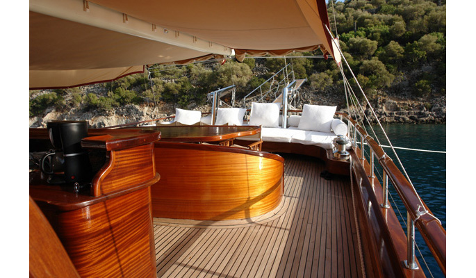 View of aft deck sofa seating area and dining table