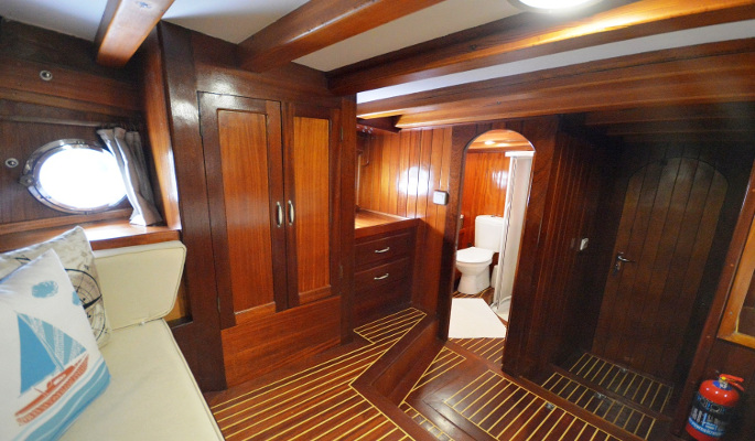 Master cabin with lounge area and en suite shower/ WC