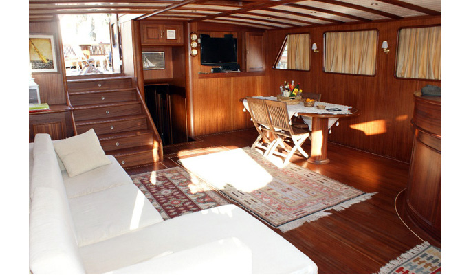 Beautifully designed interior saloon with dining area, sofa and TV/DVD/CD entertainment