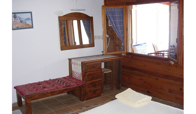 Double bedroom with view of balcony terrace with sea view